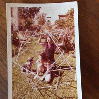 Bruce and Cathy Hamilton building a tensegrity b-boom made with salvaged poles,1972