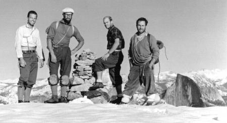 Photo of rock climbers (L to R): Tom Frost, Royal Robbins, Chuck Pratt and Yvon Chouinard on the summit of El Capitan on 30 October 1964, following the ten day ascent of the North America Wall, Yosemite National Park, California.